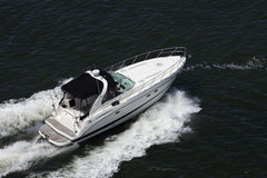 Luxury Sport Fishing Boat. Birds eye view of a speeding luxury sport fishing boat royalty free stock photo