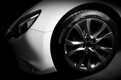 Luxury sports car close up of aluminium rim and headlight Stock Photos