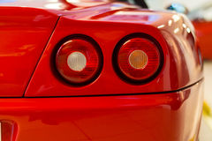 Luxury sports car rear detail. Rear corner view with twin tail lights of Ferrari sport car Stock Image