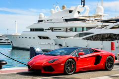 Luxury sports car and yachts at Puerto Banus in Marbella royalty free stock photography