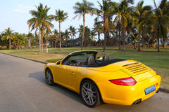 Luxury sports car. The yellow luxury sports car in street stock image