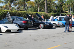 Luxury sports cars in parking lot. Lot of super cars and sports car parked at luxury hotel parking lot. The Breakers hotel parking. south Florida stock photography