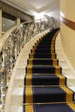 Luxury staircase. Luxury and elegant curved staircase with sophisticated banister Stock Photos