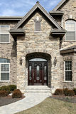Luxury stone home. With stain glass windows on door Stock Photography