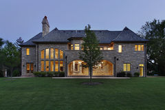 Luxury stone home at dusk. Luxury stone home in suburbs at dusk Stock Photo