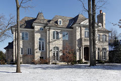 Luxury stone home in winter Stock Photos