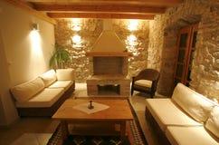 Luxury stone villa interior. Illuminated at night stock photography