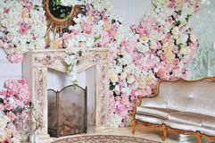 Luxury stylish interior of apartment. White walls decorated by flowers royalty free stock images