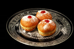 Luxury sufganiyot on a plate. Traditional Jewish food for Chanukkah holyday. Luxurious looking sufganiyot royalty free stock photos