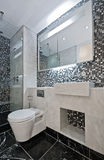 Luxury suite bathroom. Modern luxury suite bathroom with marble hand wash basin Stock Photography
