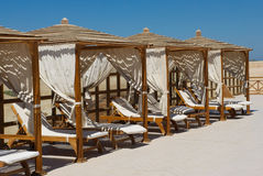 Luxury Sun Lounges on a beach in Soma Bay, Egypt Stock Image