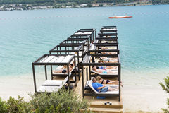 Luxury sunbeds on the beach in a hotel resort in Bodrum ,Turkey Royalty Free Stock Image
