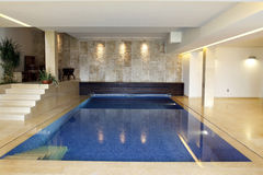 Luxury swimming pool. Interior at home Stock Image