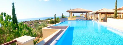 Luxury swimming pool. Sea view luxury swimming pool stock photography
