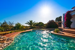 Luxury Swimming Pool. Sparkling in the evening sunshine royalty free stock photography