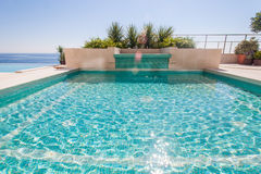 Luxury swimming pool and blue water Stock Image