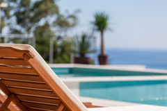 Luxury swimming pool and deck chair Royalty Free Stock Images