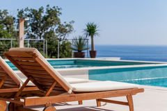 Luxury swimming pool and deck chair Royalty Free Stock Photography