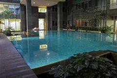 Luxury swimming pool in exclusive resort. royalty free stock images