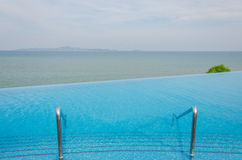 Luxury swimming pool in front of the sea Royalty Free Stock Image