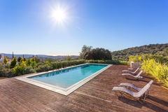 Luxury swimming pool for holidays. In the park with the sun Royalty Free Stock Photos