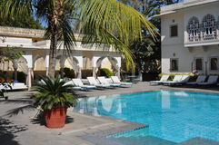 Luxury swimming pool in an hotel in India Royalty Free Stock Photo