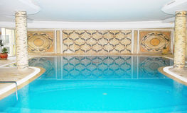 Luxury swimming pool inside spa Royalty Free Stock Image