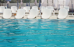 Luxury swimming pool with modern armchairs Royalty Free Stock Images