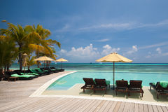 Luxury swimming pool near ocean, Maldives, Kuredu Stock Photos