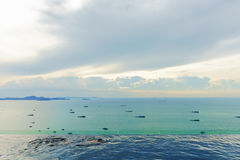 Luxury swimming pool with ocean view from Pattaya beach Stock Images