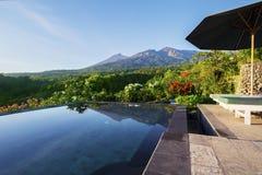 Luxury swimming pool with Rinjani mountain Royalty Free Stock Photos