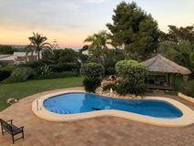 Mediterranean garden with a private swimming pool royalty free stock photos