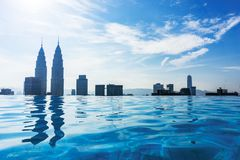 Luxury Swimming pool on the rooftop of skyscraper with city view Kuala Lumpur. royalty free stock photography