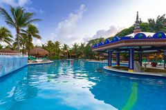 Luxury swimming pool scenery in Mexico. PLAYA DEL CARMEN, MEXICO - JULY 10, 2011: Luxury swimming pool scenery at RIU Yucatan Hotel in Playa del Carmen, Mexico Stock Photography
