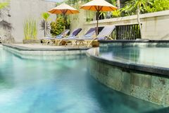 Luxury swimming pool with sunbed. Image of luxury swimming pool with sunbed in the hotel Royalty Free Stock Images