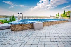 Luxury swimming pool at sunset. Royalty Free Stock Photos