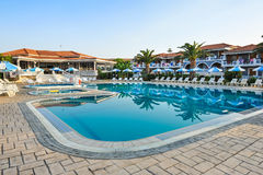 Luxury swimming pool in the tropical hotel in Greece Royalty Free Stock Photo