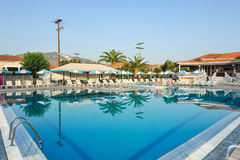 Luxury swimming pool in the tropical hotel in Greece Stock Images
