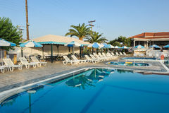 Luxury swimming pool in the tropical hotel in Greece Royalty Free Stock Photography