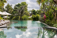 Luxury swimming pool at villa of tropical Bali island, Indonesia. Royalty Free Stock Photography