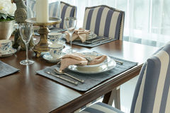 Luxury table set in classic style dining room Stock Image
