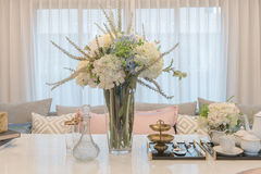 Luxury table set on dinnig table with vase of flower in dining r Royalty Free Stock Images