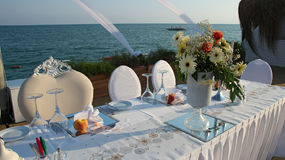 Luxury Table Setting with Candlestick by the Sea Stock Photography