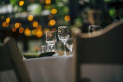 Luxury Table setting for weddings and social events. Luxury table settings for fine dining with and glassware, beautiful blurred  background. For events Stock Photography
