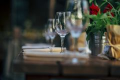 Luxury Table setting for weddings and social events. Luxury table settings for fine dining with and glassware, beautiful blurred  background. For events Royalty Free Stock Photo