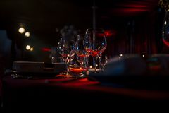 Luxury Table setting for weddings and social events. Luxury table settings for fine dining with and glassware, beautiful blurred  background. For events Stock Image