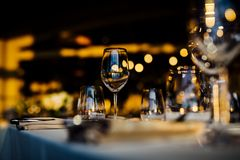 LUXURY TABLE SETTINGS 2019 for fine dining with and glassware, beautiful blurred background. For events, weddings. Preparation f