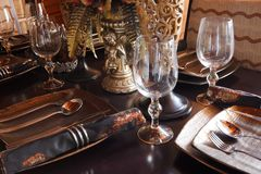 The luxury tableware. On a table Stock Photos