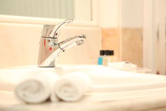 Luxury Tap water in the hotel. Tap water in a luxury hotel Stock Images