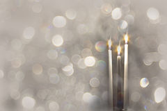 Luxury Taper Candles With Rich Silver Bokeh Stock Image